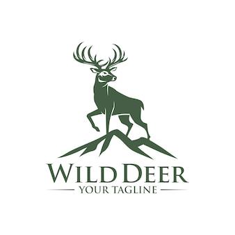 Diseño de logotipo de los ciervos en la roca