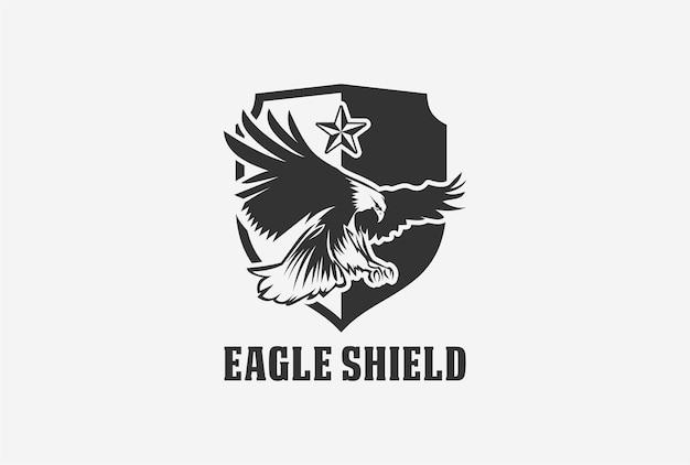 Diseño de logotipo de emblema de escudo de águila en color blanco negro.