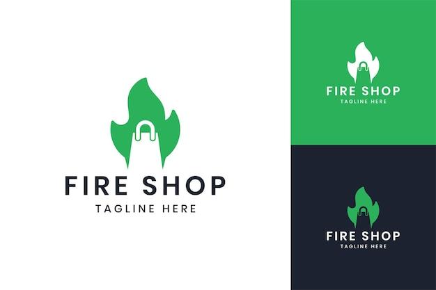 Diseño de logotipo de espacio negativo de compras de fuego