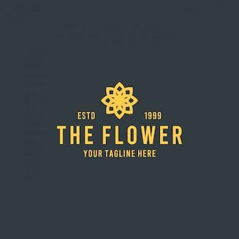 Diseño de logotipo de flor amarilla plana