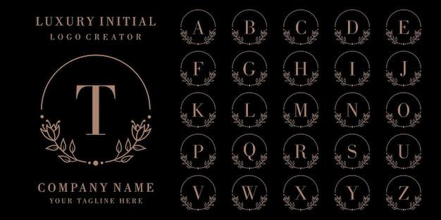Diseño de logotipo de insignia inicial de lujo con marco floral