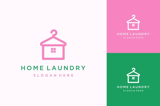 Diseño de logotipo lavandería casa casa con percha