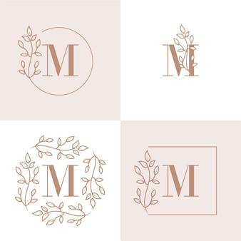 Diseño de logotipo de letra m de lujo con plantilla de fondo de marco floral