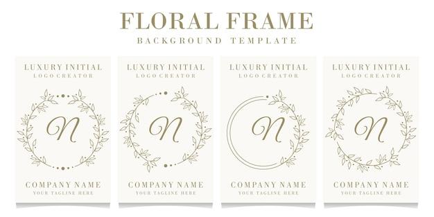 Diseño de logotipo de letra n de lujo con plantilla de fondo de marco floral