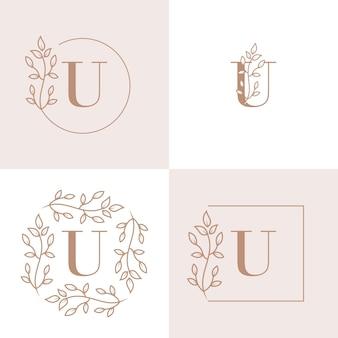 Diseño de logotipo de letra u de lujo con plantilla de fondo de marco floral