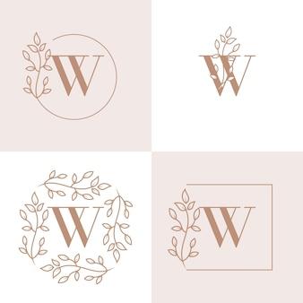 Diseño de logotipo de letra w de lujo con plantilla de fondo de marco floral