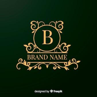 Diseño de logotipo ornamental dorado para empresas.