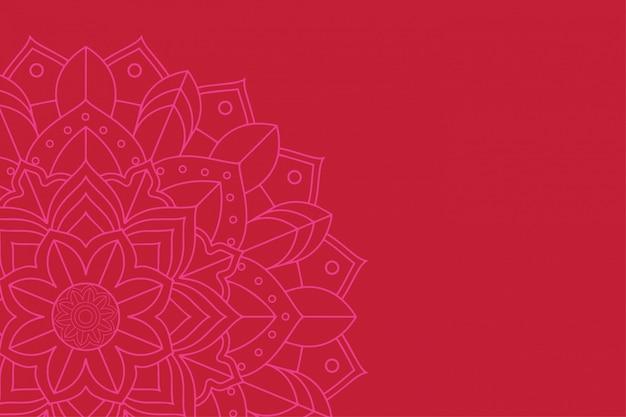 Diseño de mandala sobre fondo rojo.