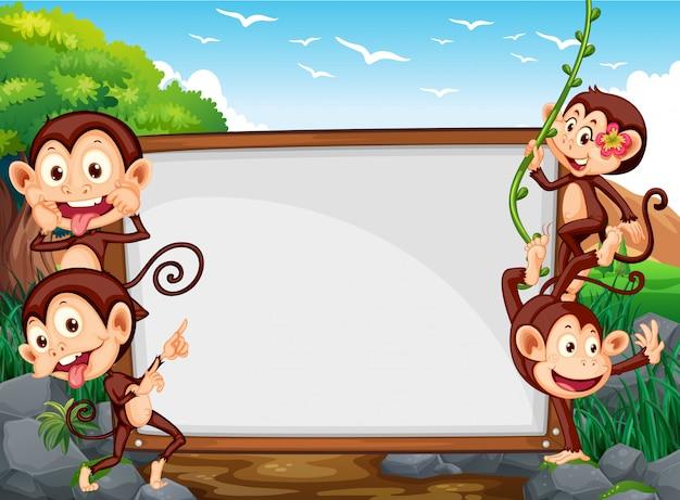 Diseño de marco con cuatro monos en el campo.
