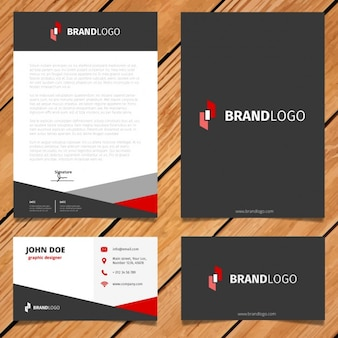 Diseño negro y rojo de papelería corporativa