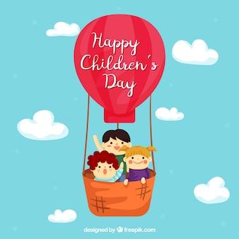 Diseño para el día de los niños con niño en globo