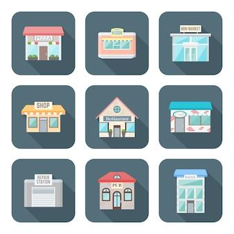 Diseño plano de color varios iconos de edificios establecen larga sombra