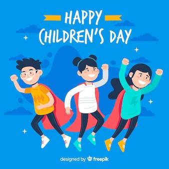 Diseño plano del día del niño con niños y capas.