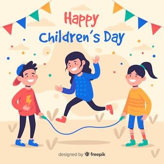 Diseño plano del día del niño con niños y guirnaldas.