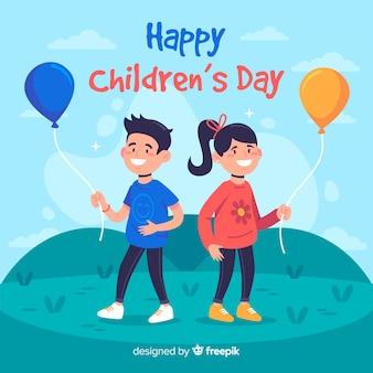 Diseño plano del día del niño con niños sosteniendo globos