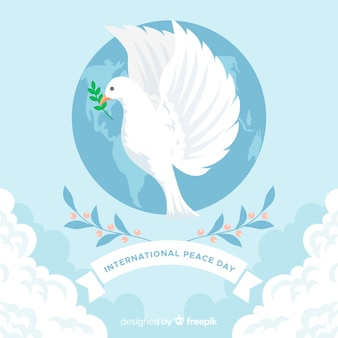 Diseño plano día de la paz con paloma
