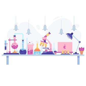 Diseño plano de un escritorio científico con objetos.