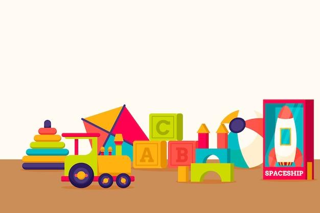 Diseño plano fondo navidad juguetes