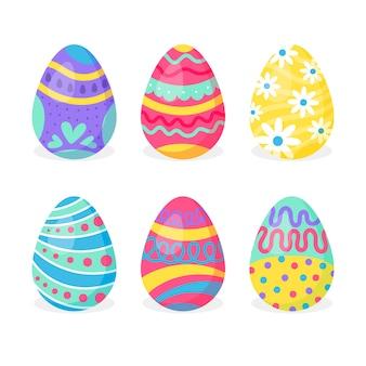 Diseño plano de huevos pintados de primavera colorida