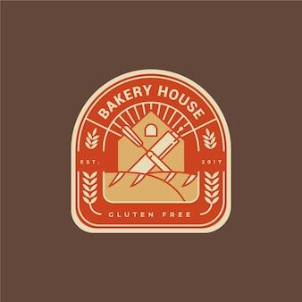 Diseño plano de logo de pastel de panadería
