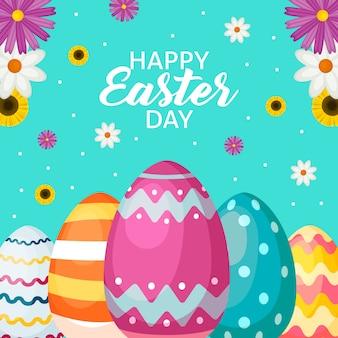 Diseño plano de pascua con huevos y flores