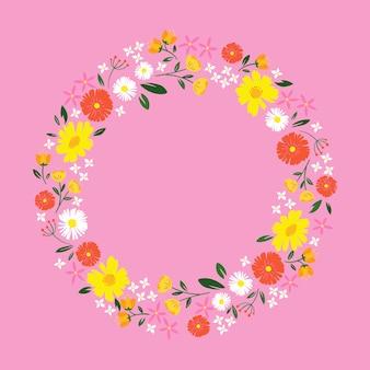 Diseño plano primavera marco floral sobre fondo rosa