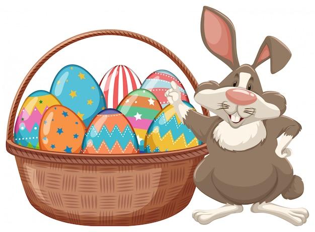 Diseño de póster para pascua con conejito de pascua y huevos
