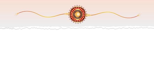Diseño de raksha bandhan rakhi en banner de papel rasgado