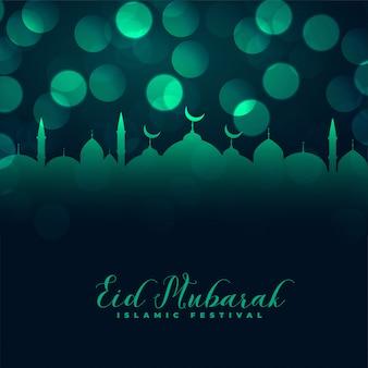 Diseño de saludo de eid mubarak mezquita islámica bokeh