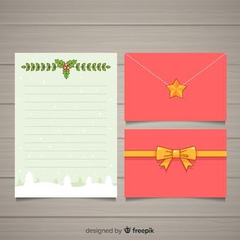Diseño de sobre y carta de navidad dibujados a mano
