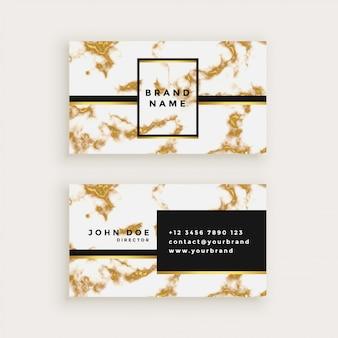 Diseño de la tarjeta busienss en textura de mármol dorado