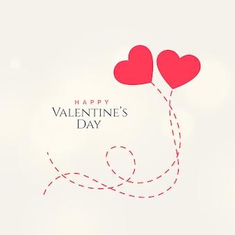 Diseño de tarjeta dulce del día de san valentín con dos corazones flotantes