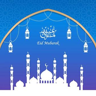 Diseño de tarjeta de felicitación eid mubarak con silueta mezquita y linterna