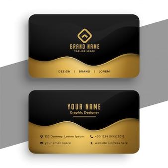 Diseño de tarjeta de presentación en colores negro y dorado.