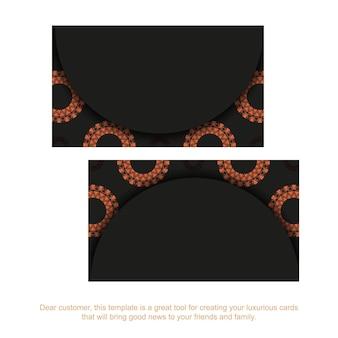Diseño de tarjeta de visita en negro listo para imprimir con patrones naranjas. plantilla de tarjeta de visita con lugar para el texto y adornos vintage.