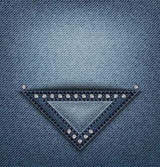 Diseño triangular de blue jeans con pespuntes y lentejuelas sobre denim.