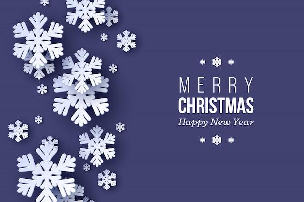 Diseño de vacaciones de navidad con copos de nieve de estilo de corte de papel. fondo azul oscuro con texto de saludo, fondo.