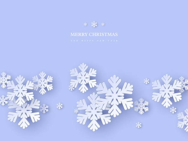 Diseño de vacaciones de navidad con copos de nieve de estilo de corte de papel. fondo azul con texto de saludo, fondo