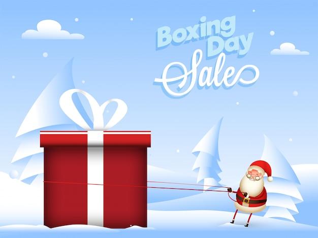 Diseño de venta de boxing day con papel cortado árbol de navidad e ilustración de santa tirando de la cuerda de la caja de regalo en la nieve