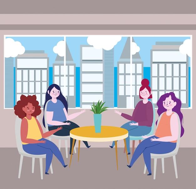 Distanciamiento social restaurante o cafetería, las mujeres sentadas a la mesa mantienen distancia