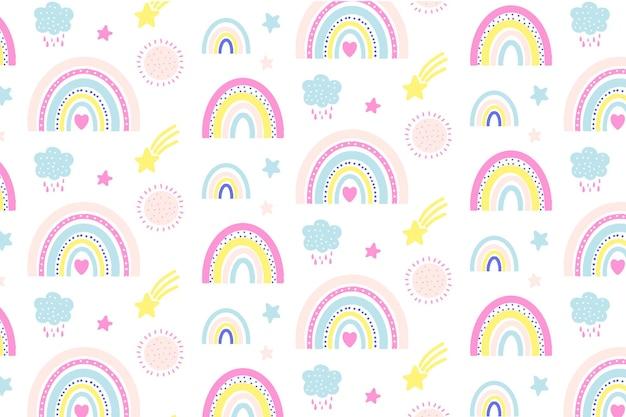 Divertido y colorido patrón de arco iris dibujado a mano con estrellas, soles y nubes