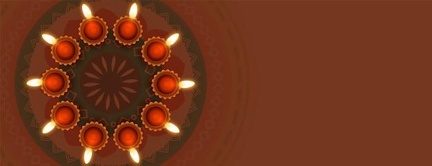 Diya y rangoli para el festival diwali
