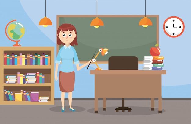 Docente en el aula con librero y pizarra educativa.