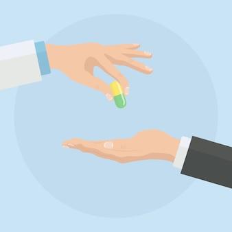 Doctor dando pastillas al paciente. el hombre sostiene la cápsula en la mano