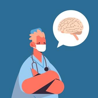Doctor masculino en máscara protectora burbuja de chat con medicina sanitaria del cerebro humano