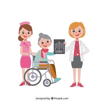 Doctora, enfermera y mujer en silla de ruedas