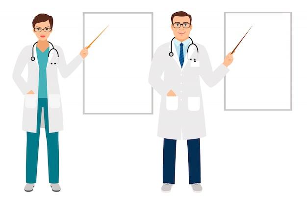 Doctores de sexo femenino de sexo masculino que se colocan y que señalan en el tablero de la presentación en blanco aislado con el copyspace