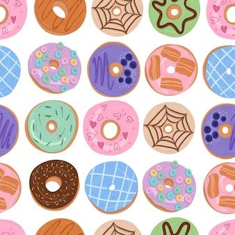 Donuts de patrones sin fisuras dibujos animados dibujados a mano