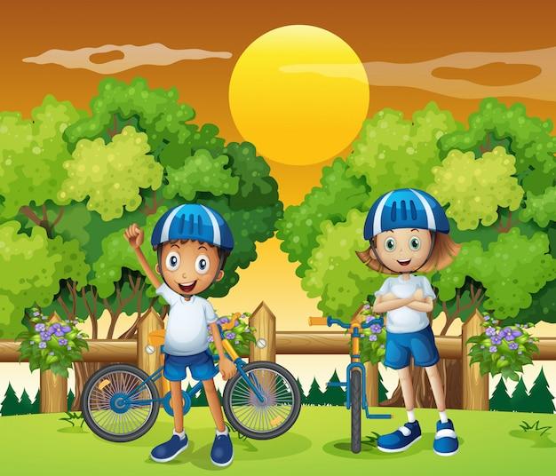 Dos adorables niños en bicicleta