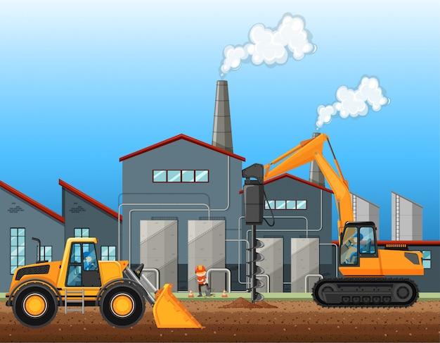 Dos camiones de construcción en la escena de la fábrica.